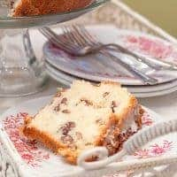 This White Chocolate Cake is a delicious, decadent, comfort food cake rich with butter and full of white chocolate, pecans, and coconut. From @NevrEnoughThyme https://www.lanascooking.com/white-chocolate-cake/