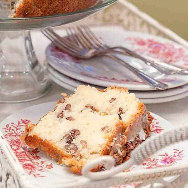 This White Chocolate Cake is a delicious, decadent, comfort food cake rich with butter and full of white chocolate, pecans, and coconut. From @NevrEnoughThyme http://www.lanascooking.com/white-chocolate-cake