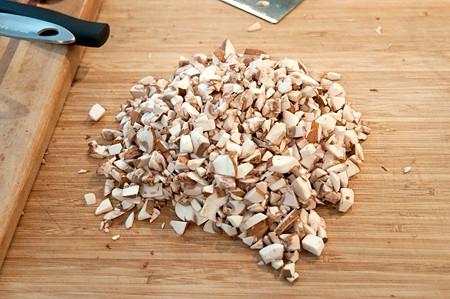 Minced mushrooms on a cutting board.