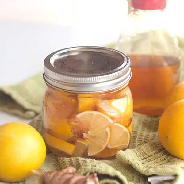 This Lemon, Honey, and Ginger combination is an old-fashioned homemade soother for colds and sore throats. Use it alone or in a cup of warm tea. From @NevrEnoughThyme https://www.lanascooking.com/lemon-honey-and-ginger-soother-for-colds-and-sore-throats/