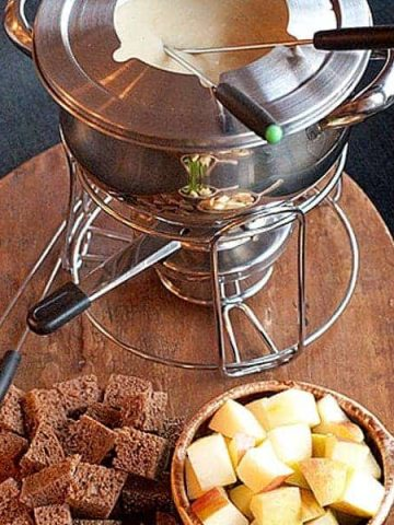 A classic cheese fondue using both Swiss and Gruyere cheese with bread and fruit dippers. One of our favorites for a relaxed Sunday afternoon. https://www.lanascooking.com/cheese-fondue/