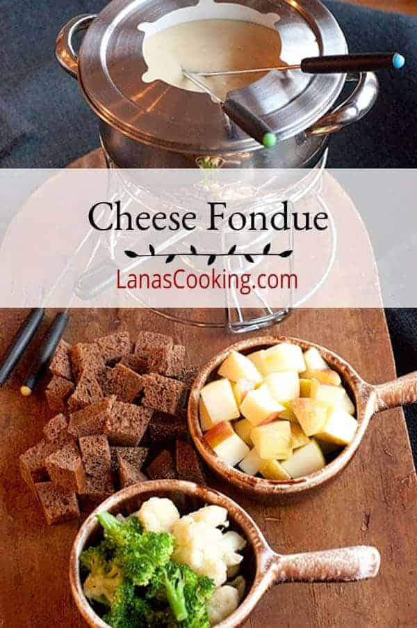 A classic cheese fondue using both Swiss and Gruyere cheese with bread and fruit dippers. One of our favorites for a relaxed Sunday afternoon. From @NevrEnoughThyme https://www.lanascooking.com/cheese-fondue/