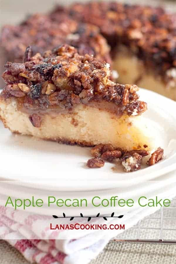 This apple pecan coffee cake has a moist, buttery cake layer topped with apple slices and a crunchy pecan and brown sugar crumble. From @NevrEnoughThyme https://www.lanascooking.com/apple-pecan-coffee-cake