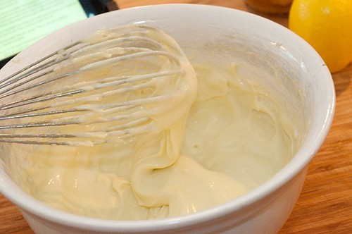 Finished mayonnaise and whisk in a mixing bowl.