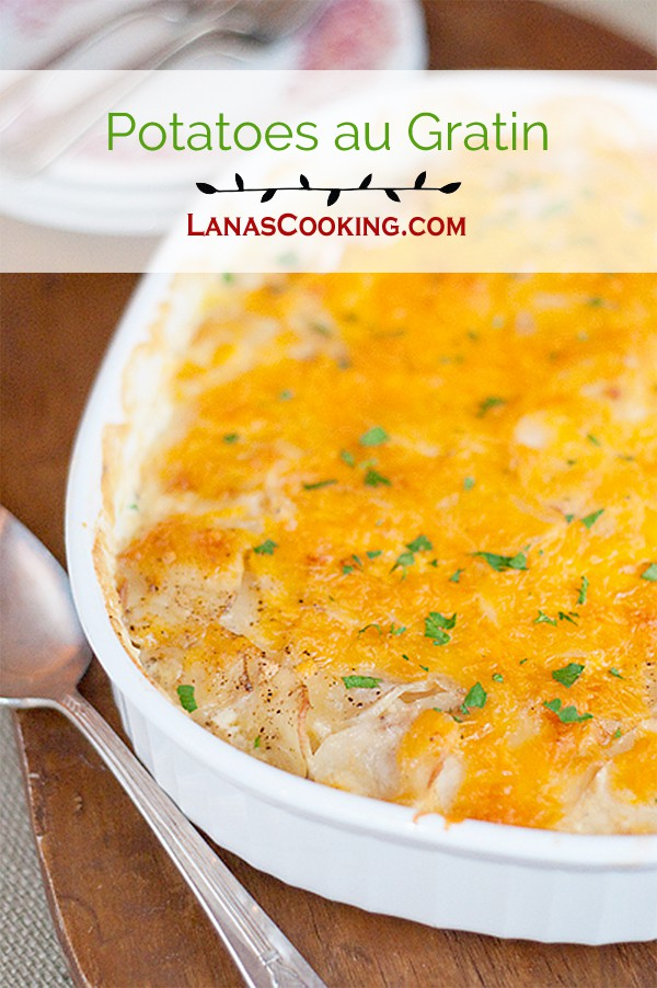 Potatoes au Gratin - potatoes baked in a rich creamy sauce with garlic and cheddar cheese. From @NevrEnoughThyme https://www.lanascooking.com/potatoes-au-gratin