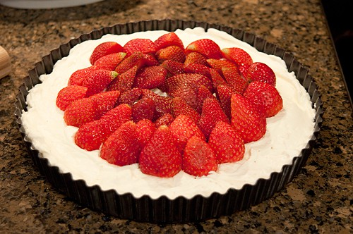Whole fresh strawberries arranged over the whipped cream layer.