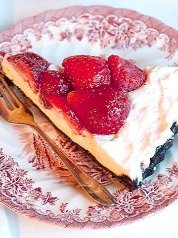 Fresh Strawberry Pie with Chocolate Cookie Crust - A glorious fresh strawberry pie with a whipped cream and cream cheese layer over chocolate cookie crust. From @NevrEnoughThyme https://www.lanascooking.com/fresh-strawberry-pie-with-chocolate-cookie-crust/