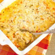 This Chicken Artichoke Casserole combines cooked chicken with veggies, rice, and cheese for a delicious one-dish supper. https://www.lanascooking.com/chicken-artichoke-casserole/