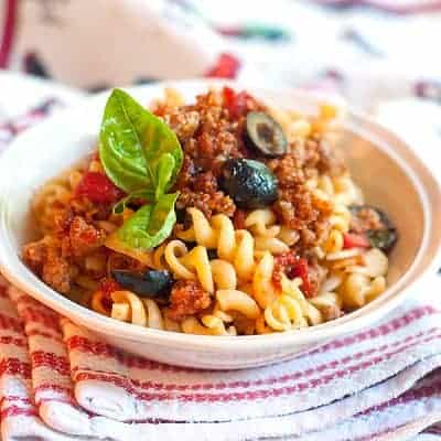 Italian Sausage and Rotini - a quick, simple weeknight dinner. Pasta with an Italian sausage, tomato, and black olive sauce. From @NevrEnoughThyme https://www.lanascooking.com/italian-sausage-and-rotini/