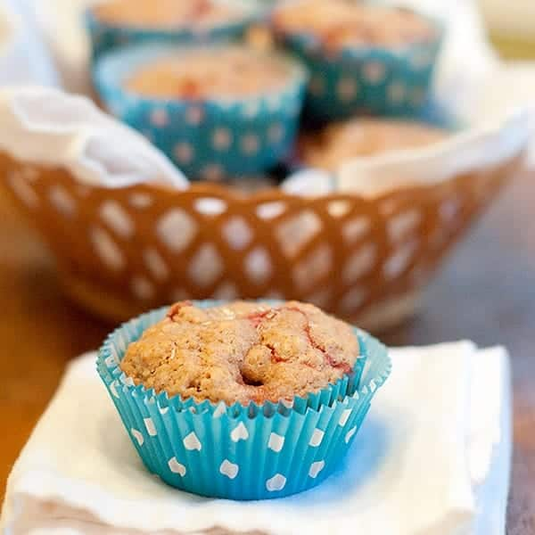 These Strawberry Lemon Muffins are delicious for breakfast or as an afternoon snack. They're made a bit healthier by using oatmeal and whole wheat flour. From @NevrEnoughThyme https://www.lanascooking.com/strawberry-lemon-muffins/