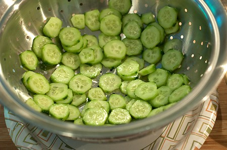 Drain the cucumber for Cucumber Salad with Sour Cream and Dill