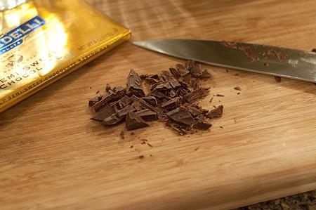 Chopping chocolate on a board.