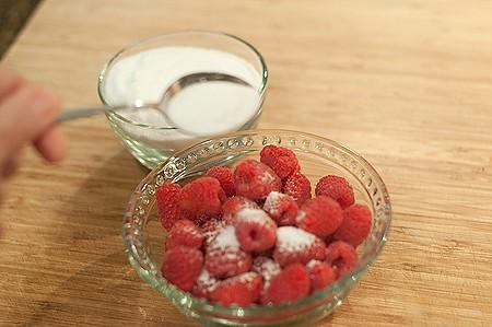 Sprinkling berries with sugar.