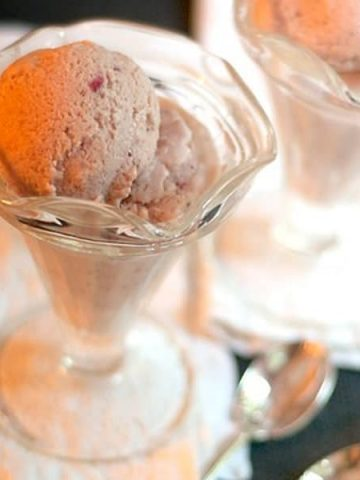Rich, decadent, homemade strawberry ice cream. A summer time treat! From @NevrEnoughThyme https://www.lanascooking.com/homemade-strawberry-ice-cream/