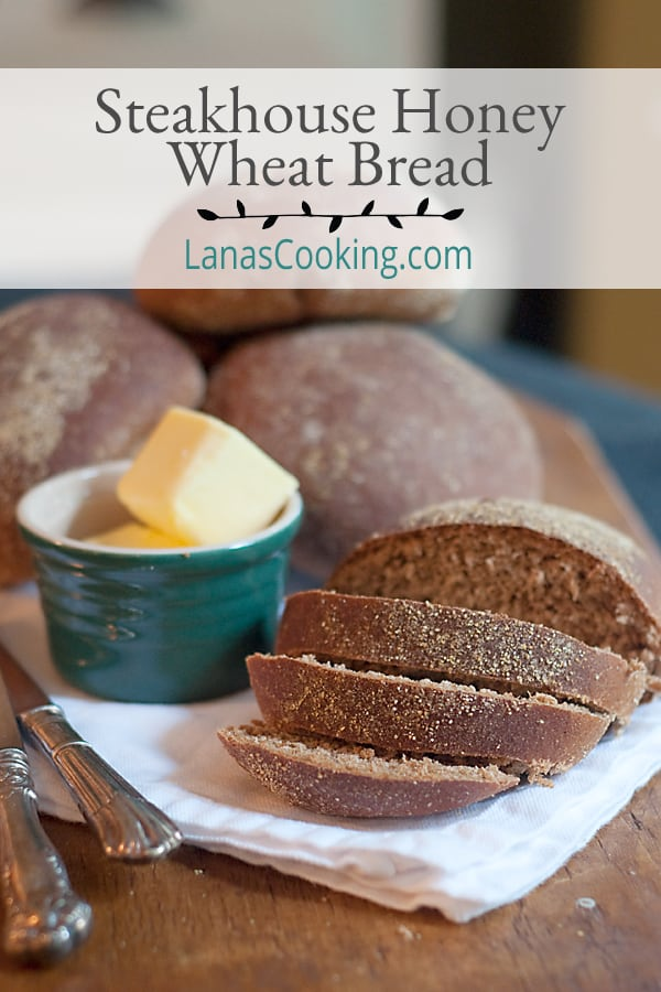 Steakhouse Honey Wheat Bread - a copycat recipe of the famous dark honey wheat bread served at Outback Steakhouse. Slather on the butter and enjoy! From @NevrEnoughThyme https://www.lanascooking.com/steakhouse-honey-wheat-bread/