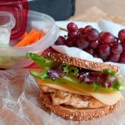 This Grilled Chicken, Apple, and Gouda Sandwich on whole grain bread is a healthy, hearty lunch option. Treat yourself to a real lunch break! https://www.lanascooking.com/grilled-chicken-apple-gouda-sandwich