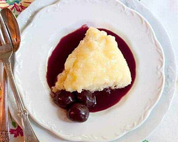 Lemon Pudding Cake with Cherry Coulis