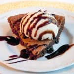 This Vintage Hot Fudge Pie is a cross between a brownie and a cookie. A real old-fashioned treat that's perfect for chocolate lovers of all ages! https://www.lanascooking.com/vintage-hot-fudge-pie/
