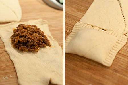 Filling the crescent roll dough with beef filling.