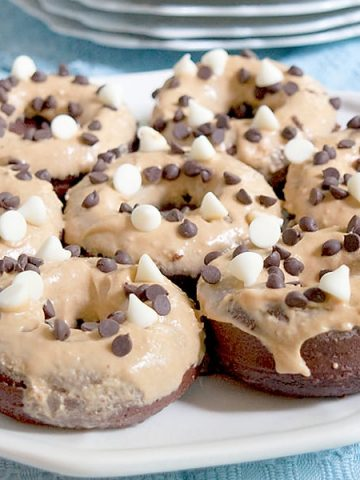 Baked Chocolate Doughnuts with Peanut Butter Frosting. Cut out the frying and reduce the calories with these baked chocolate doughnuts. From @NevrEnoughThyme https://www.lanascooking.com/baked-chocolate-doughnuts-peanut-butter-frosting/