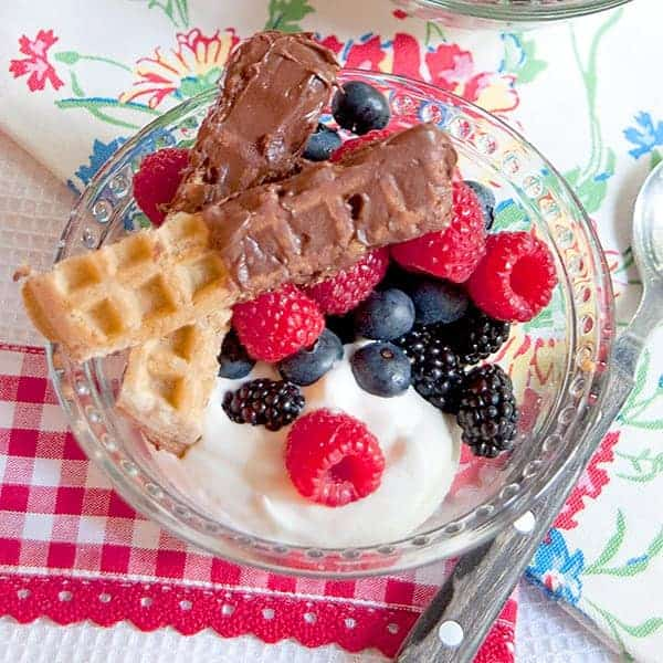 Chocolate Caramel Dipped Waffle Sticks with Fresh Berries and Cream - this recipe uses purchased frosting to make chocolate caramel dipped waffle sticks. From @NevrEnoughThyme https://www.lanascooking.com/chocolate-caramel-dipped-waffle-sticks-fresh-berries-cream/
