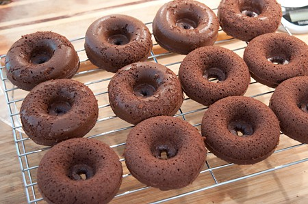 Cooling Baked Chocolate Doughnuts