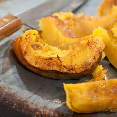 Baked Acorn Squash - tender, sweet, and buttery baked acorn squash is the perfect side dish for a Fall dinner. From @NevrEnoughThyme https://www.lanascooking.com/baked-acorn-squash/