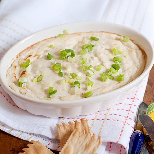 This luscious Hot Baked Crab Dip with cream cheese and horseradish is the perfect appetizer for your next dinner party or get-together with friends. From @NevrEnoughThyme https://www.lanascooking.com/hot-baked-crab-dip/