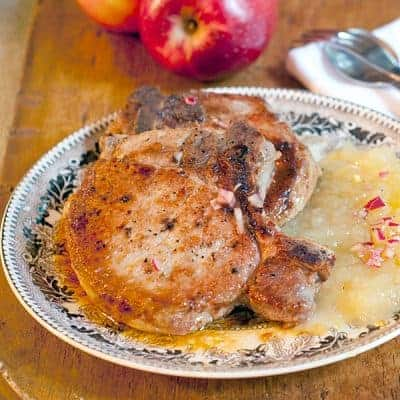 Pork Chops with Apple Puree - Perfectly pan-seared pork chops with apple puree topped with shallot vinaigrette. Great for a casual dinner party. From @NevrEnoughThyme https://www.lanascooking.com/pork-chops-apple-puree