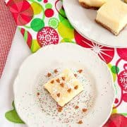 Peanut Butter Chocolate Chunk Cookie Cheesecake Squares - these delicious cheesecake squares are easy to make using a packaged cookie mix for the crust. https://www.lanascooking.com/peanut-butter-chocolate-chunk-cookie-cheesecake-squares/