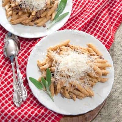 Penne with Creamy Guanciale Sauce - Penne pasta tossed with a creamy sauce made with guanciale (or pig jowls), garlic, sun-dried tomatoes, and sage. From @NevrEnoughThyme https://www.lanascooking.com/penne-creamy-guanciale-sauce