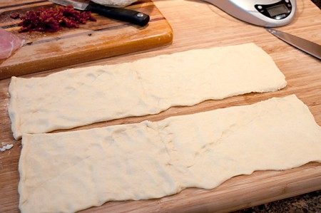 Prepping crescent rolls for Prosciutto Ricotta Pinwheels