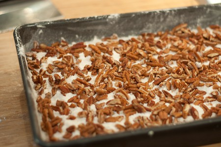 Sprinkle pecans over dry cake mix