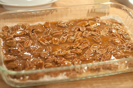 Carmel poured over pecans and crust in baking dish.