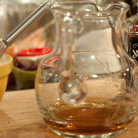 Adding bourbon for Mocha Eggnog Sundae