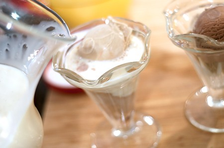 Pour eggnog over ice cream