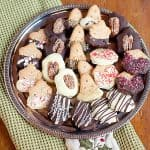 Great ideas for Quick and Easy Decorated Christmas Cookies using purchased cookies, chocolate chips, and other ingredients. From @NevrEnoughThyme https://www.lanascooking.com/quick-easy-decorated-christmas-cookies/