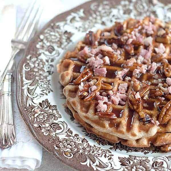 Waffles with Ham and Pecan Praline Syrup - waffles baked with ham right in the batter and topped with delicious pecan praline syrup. From @NevrEnoughThyme https://www.lanascooking.com/waffles-ham-pecan-praline-syrup/