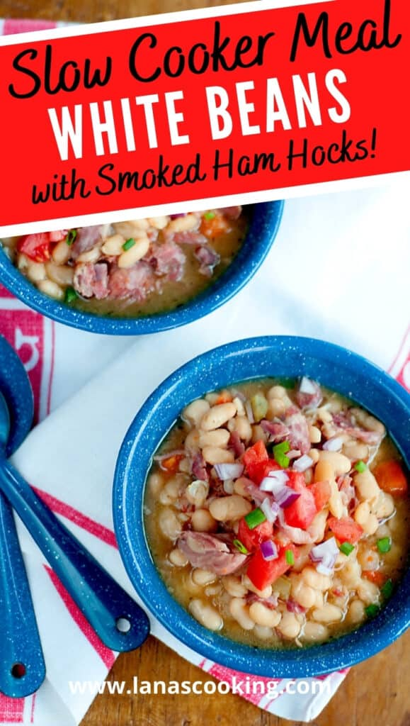 Two bowls of Slow Cooker White Beans with Smoked Ham Hocks presented on a wooden board with a kitchen towel and spoons. Text overlay for pinning.
