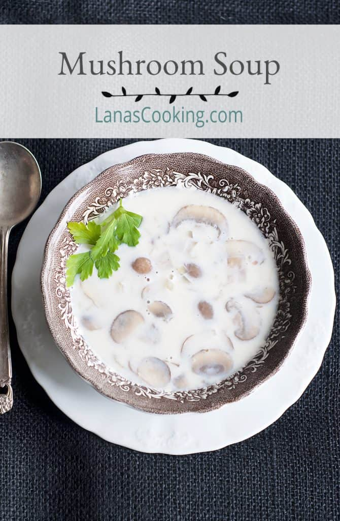 A serving of Cremini Mushroom Soup in a vintage serving dish.
