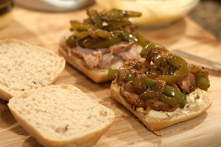 Assemble Pork Tenderloin Sandwich with Peppers and Onions