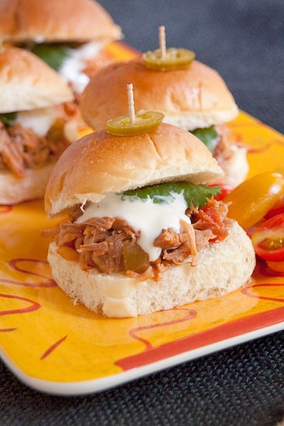 These pulled pork sliders will be a game day favorite. They're made with slow cooked pulled pork seasoned with southwest flavors. From @NevrEnoughThyme http://www.lanascooking.com/southwest-pulled-pork-sliders-slow-cooker