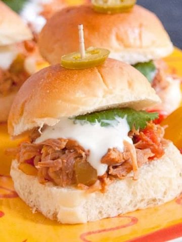 Southwest Pulled Pork Sliders from the Slow Cooker will be a game day favorite. They're made with slow cooked pulled pork seasoned with southwest flavors. From @NevrEnoughThyme https://www.lanascooking.com/southwest-pulled-pork-sliders-slow-cooker