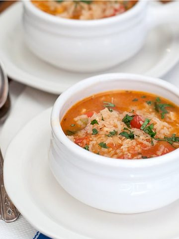 Spanish Rice and Chicken Soup - a lovely version of chicken soup flavored with garlic, cilantro, tomatoes, and taco seasoning. https://www.lanascooking.com/spanish-rice-chicken-soup/