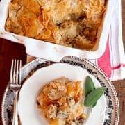 Chicken, Leek, and Mushroom Pie - a lovely, savory pie with a chicken, leek, mushroom and potato filling. A crispy phyllo topping makes the dish lighter. https://www.lanascooking.com/chicken-leek-mushroom-pie
