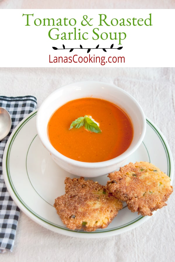 Tomato and Roasted Garlic Soup is a classic tomato soup recipe with the addition of roasted garlic. Perfect for dipping with a grilled cheese sandwich. From @NevrEnoughThyme https://www.lanascooking.com/tomato-roasted-garlic-soup