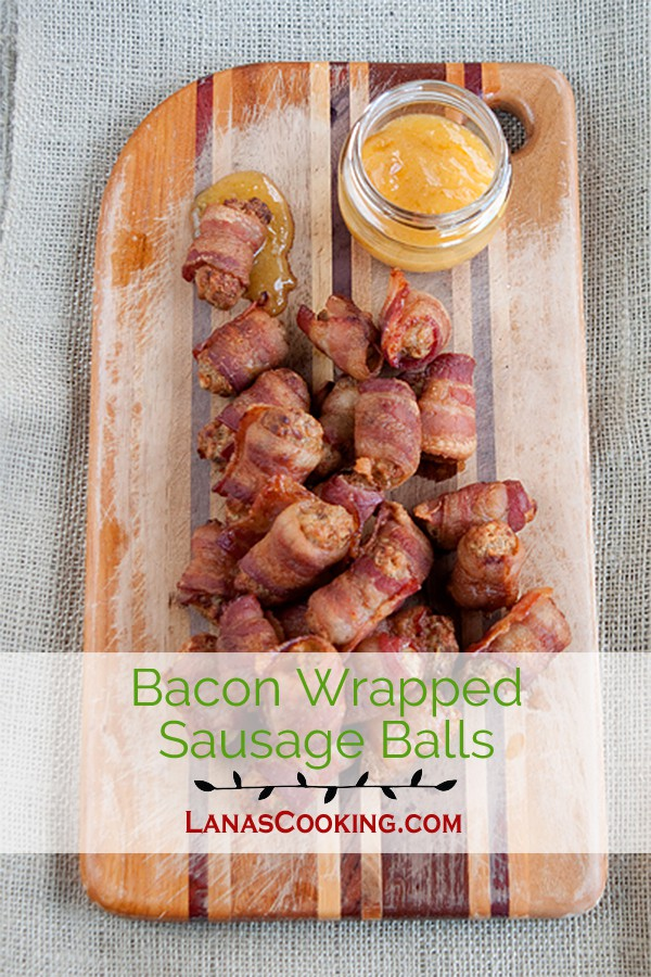 Bacon Wrapped Sausage Balls - Spicy, herby, cheesy sausage balls wrapped in bacon and served with a peach-Dijon dipping sauce. From @NevrEnoughThyme http://www.lanascooking.com/bacon-wrapped-sausage-balls
