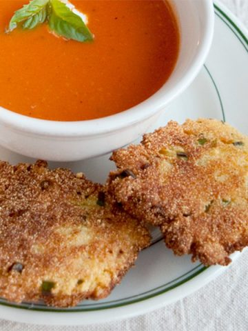 These crispy Cornmeal Scallion Fritters are the perfect accompaniment to soups and stews and are a great side with fresh summer vegetables. From @NevrEnoughThyme https://www.lanascooking.com/cornmeal-scallion-fritters/
