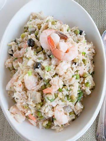 Shrimp and Rice Salad - a delicious supper salad with rice, shrimp, artichoke hearts, and black olives. https://www.lanascooking.com/shrimp-rice-salad