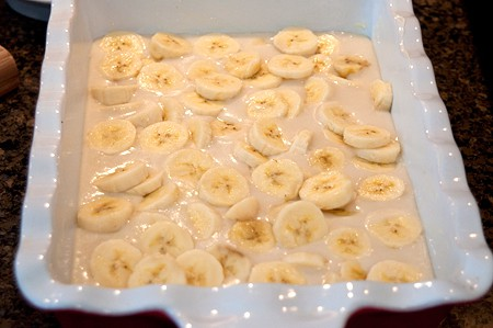 Top the Banana Bread Cobbler batter with banana slices